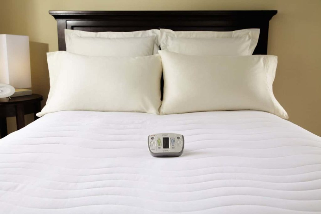 A heated mattress pad