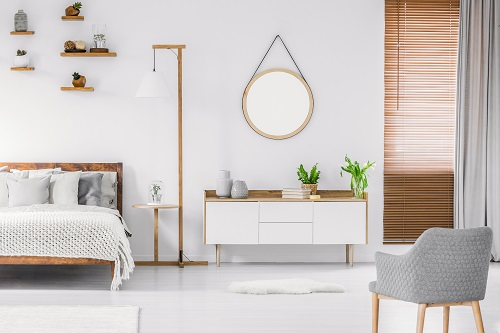 Wooden Bed In White Interior